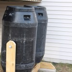 Side view of dual compost tumblers