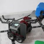Robotics club robot picking up a block
