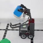 Robotics club robot picking up a block 3