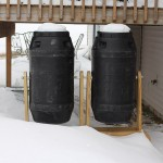 compost tumblers covered in snow