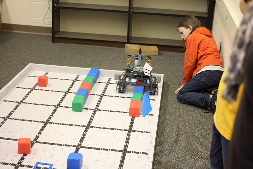 robotics club helping teammates