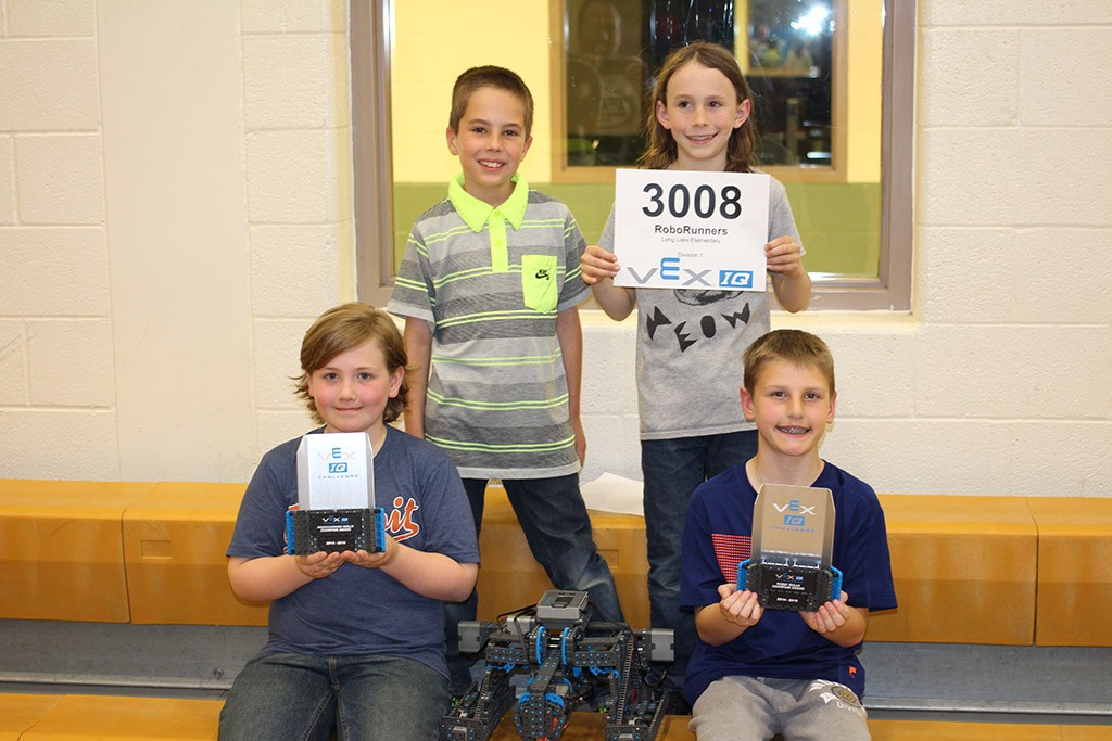 robotics club team members and trophies