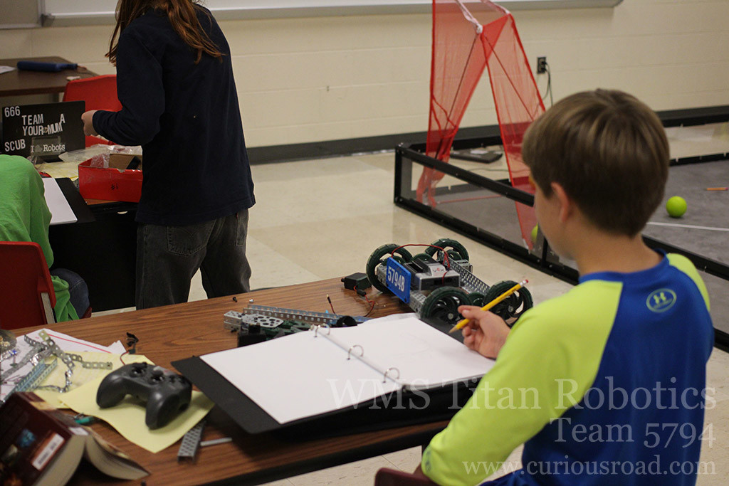 One of the robotics teams thinking out some design modifications