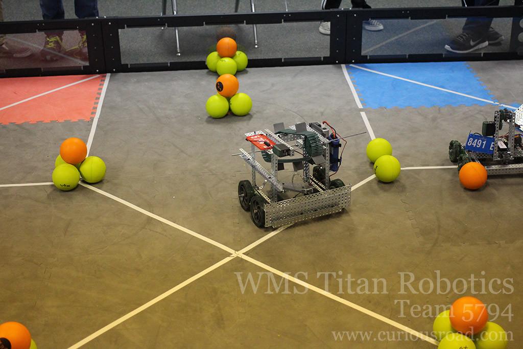 Robotics club team 5794D moving across the field