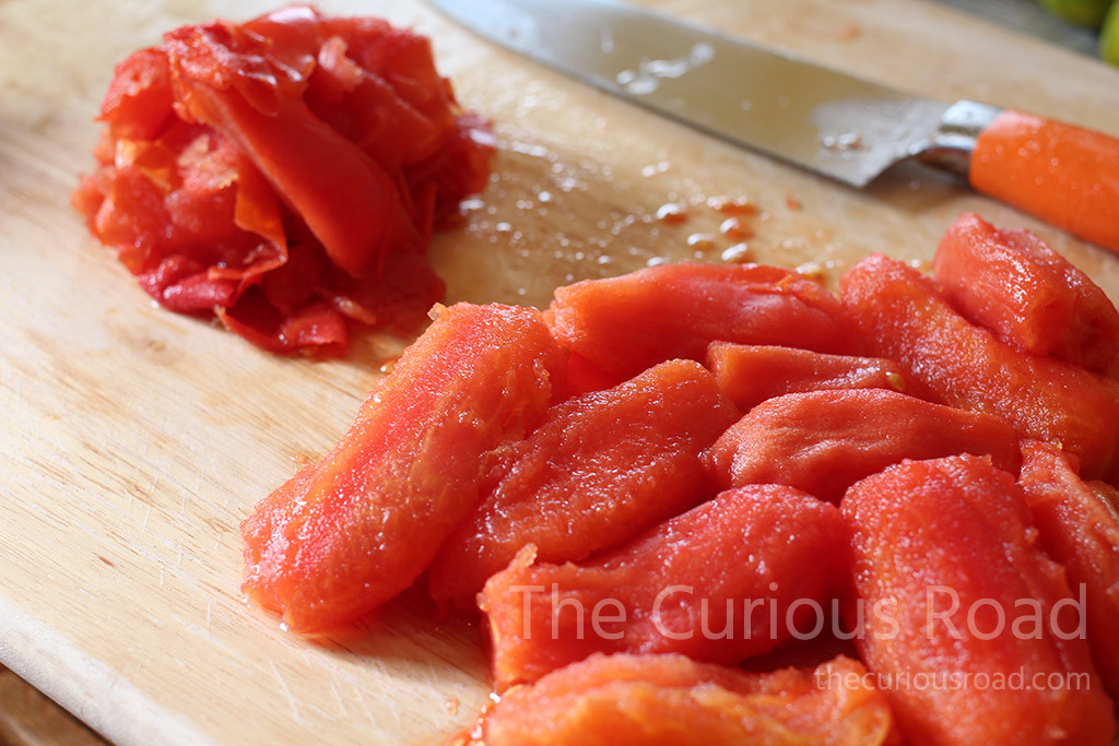 Blanch the tomatoes to remove skins