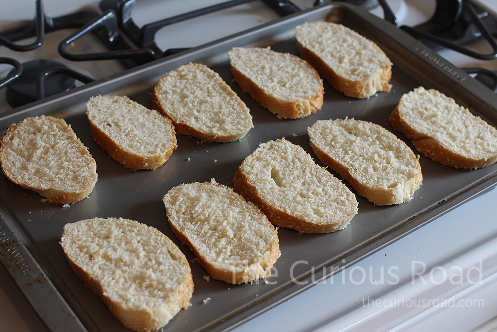 Slice bread and place on a cookie sheet