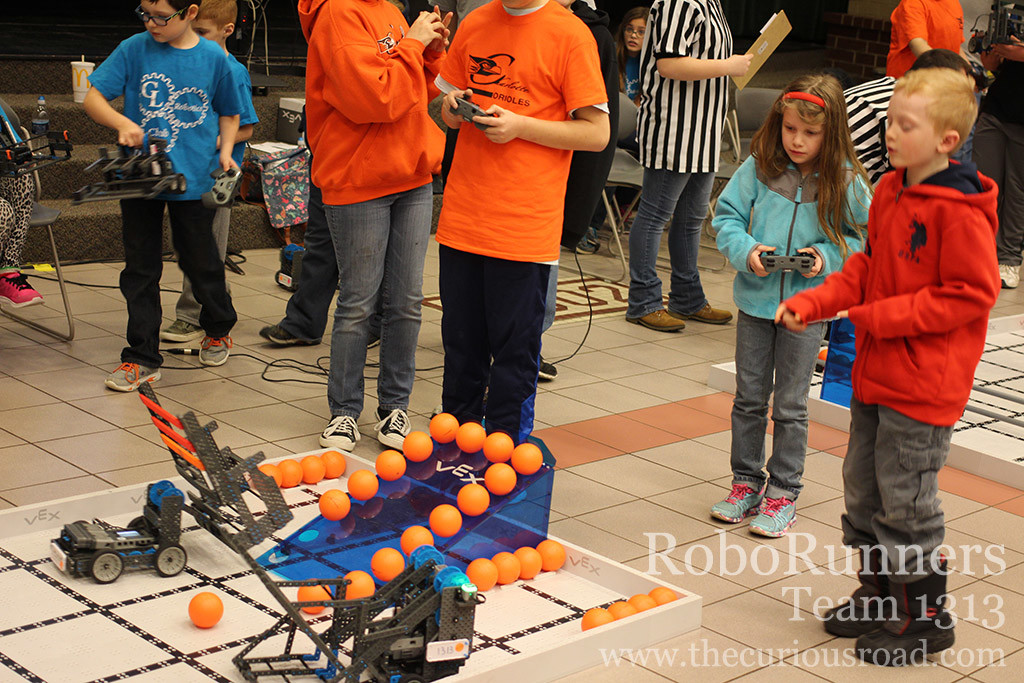 Elementary students driving robots