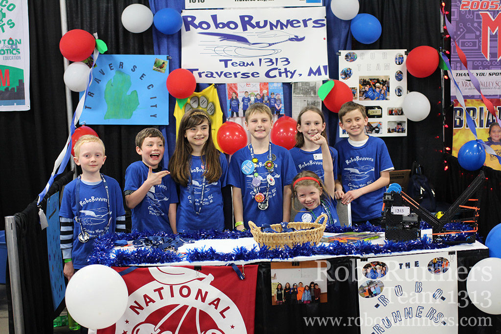 RoboRunners posing in their booth at VEX Worlds