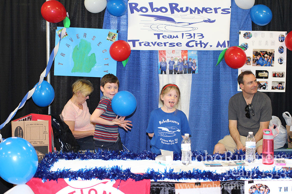 RoboRunners having fun in their booth